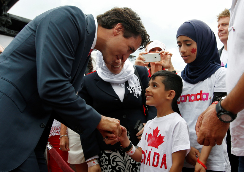 Canada's PM Trudeau shakes hands with a Syrian refugee during Canada Day celebrations on Parliament Hill in Ottawa